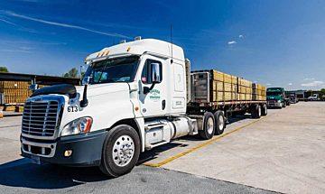 CM Tucker Lumber truck carrying lumber