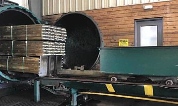 Pressure-treating lumber